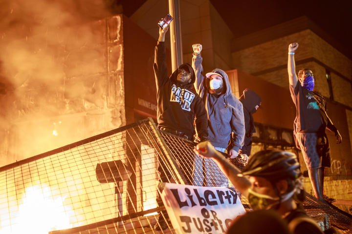 Protesters in front of the burning Third Police Precinct in Minneapolis, in a third day of demonstrations over the police killing of George Floyd.