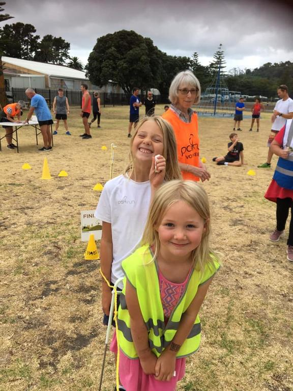 Shelagh Saprunoff (back) volunteering at Gisborne parkrun with grandchildren Zosia (front) and Ivy Costello.