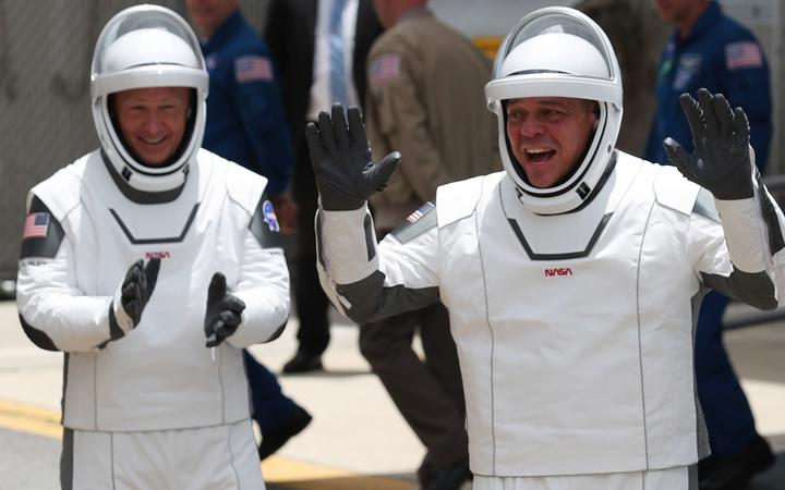 CAPE CANAVERAL, FLORIDA - MAY 27: NASA astronauts Bob Behnken (R) and Doug Hurley (L) walk out of the Operations and Checkout Building on their way to the SpaceX Falcon 9 rocket with the Crew Dragon spacecraft at the Kennedy Space Center on May 27, 2020 in Cape Canaveral, Florida.
