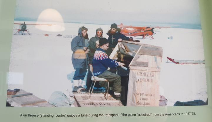 This iconic photo shows the Scott Base pian , shortly after it was acquired by the New Zealanders, being played on the sea ice.