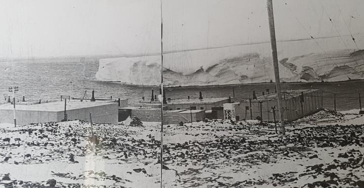 A photo of the original Scott Base built in 1957. The glacier in the background no longer exists.