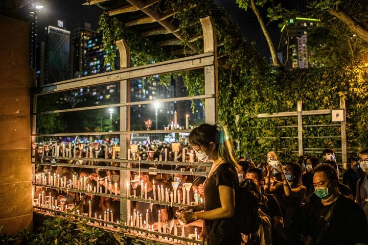 Tens of thousands of people across Hong Kong lit candles and chanted democracy slogans to commemorate China's deadly Tiananmen crackdown, defying a ban against gathering as tensions seethed over a planned new security law.