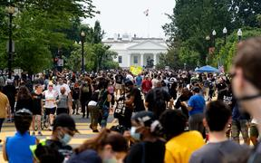 Protestors gather along 16th St north of the White House, speaking out against systemic inequality and police brutality, June 6, 2020.