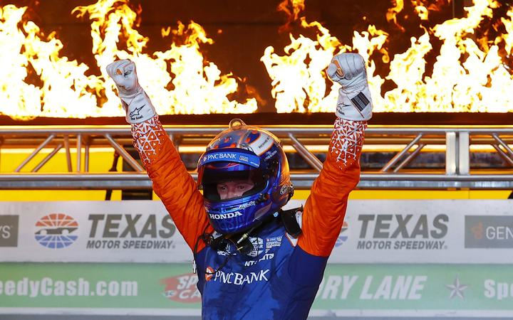 FORT WORTH, TEXAS - JUNE 06: Scott Dixon, driver of the #9 PNC Bank Chip Ganassi Racing Honda, celebrates in Victory Lane after winning the NTT IndyCar Series - Genesys 300 at Texas Motor Speedway on June 06, 2020 in Fort Worth, Texas.   Tom Pennington/Getty Images/AFP