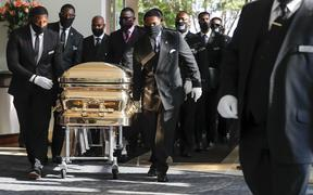 Pallbearers bring the coffin into the church for the funeral of George Floyd on June 9, 2020, in Houston, Texas
