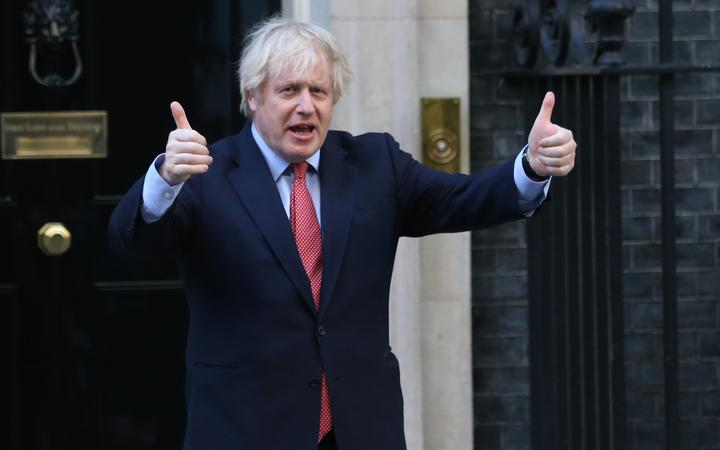 "LONDON, UNITED KINGDOM - MAY 28: British Prime Minister Boris Johnson gives thumbs up outside 10 Downing Street in London, United Kingdom on May 28, 2020, as part of the national ""clap for carers"" to show thanks for the work of Britain's National Health Service (NHS) workers"