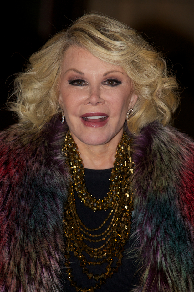 This November 28, 2012 file photo shows US television personality and comedian Joan Rivers on the red carpet as she arrives at the Prince's Trust comedy gala 'We Are Most Amused' at the Royal Albert Hall in London.