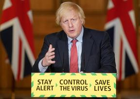 A handout image released by 10 Downing Street, shows Britain's Prime Minister Boris Johnson attending a remote press conference to update the nation on the COVID-19 pandemic.