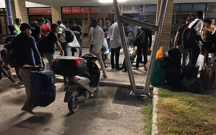 Refugees gather at Nauru airport for transfer to the US, 11-6-20.