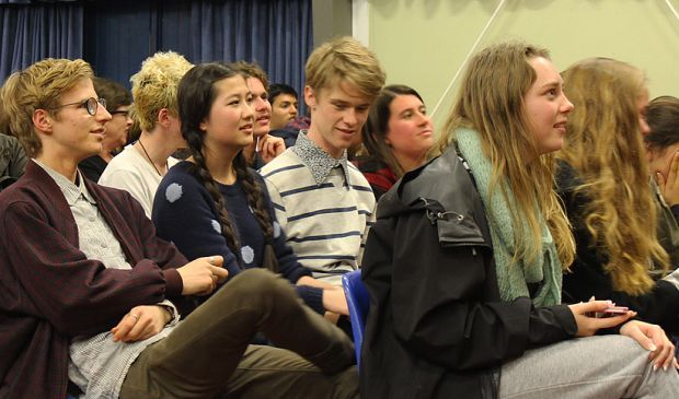 Young people in an audience at an election debate organised by Auckland  youth community leaders