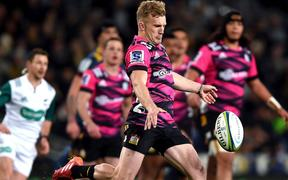 Damian McKenzie of the Chiefs, unleashes a kick during the Super Rugby Aotearoa match between the Highlanders and the Chiefs in Dunedin.