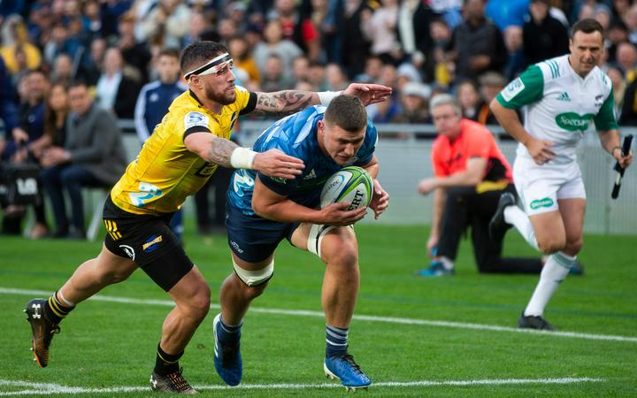 Blues loose forward Dalton Papali'i scores during the Super Rugby Aotearoa match against the Hurricanes at Eden Park.