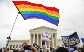 (File photo) Demonstrators in favour of LGBT rights rally outside the US Supreme Court in Washington, DC, in October 2019 as the court considers three cases dealing with workplace discrimination based on sexual orientation.