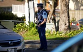Police at Reynella Drive in Massey, west Auckland.