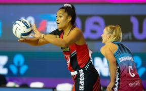 Tactix goal keep Teamlisi Fakahokotau clears the ball under close scrutiny from Steel centre Shannon Saunders.