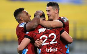 Crusaders David Havili celebrates his try with team mates Sevu Reece and Will Jordan.