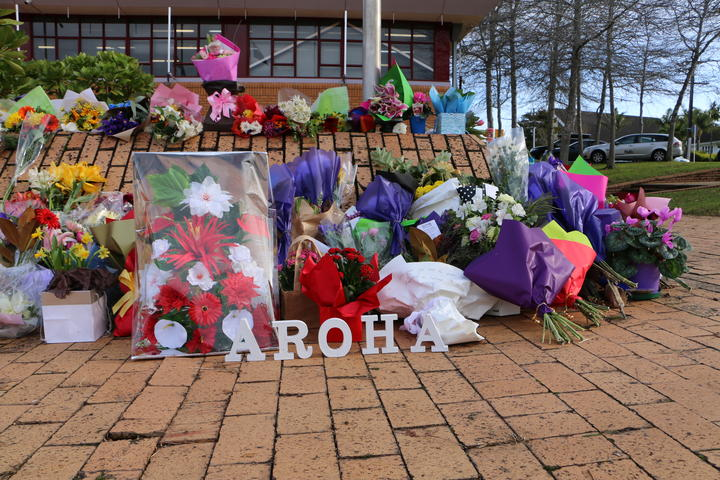 Flowers outside the Henderson police station in memory of Constable Matthew Hunt.