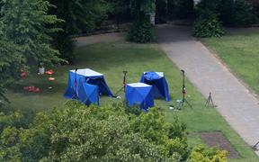 A picture shows police tents and equipment at the scene of a fatal stabbing incident that is being treated as terrorism in Forbury Gardens park in Reading, west of London, on June 21, 2020.
