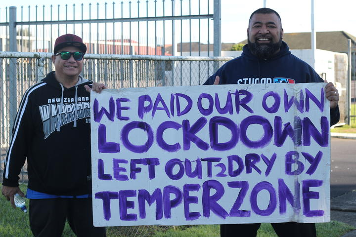 Afa Apoua and his uncle picketing outside Temperzone