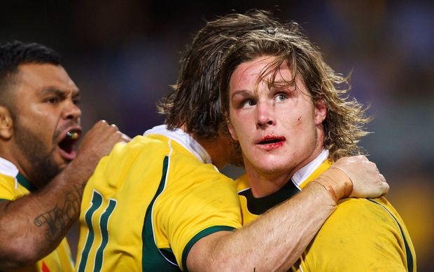 Bloodied Wallabies skipper Michael Hooper celebrates the win over the Boks