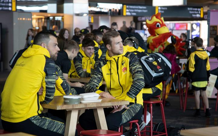 Wellington Phoenix players say goodbye to fans at Wellington airport.