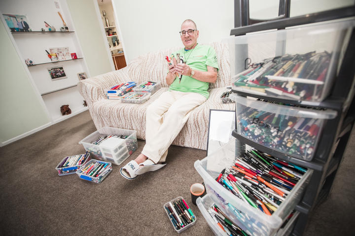 Kevin Upjohn with his pen collection