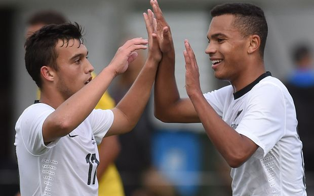 Clayton Lewis and Elijah Neblett celebrate a goal against Papua New Guinea, Auckland, 2014.