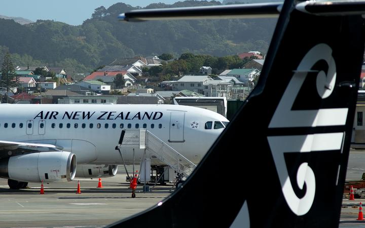 An Air New Zealand airplane wait for passengers at Wellington International airport on February 20, 2020.