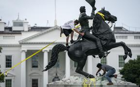 Protesters attempt to pull down the statue of Andrew Jackson in Lafayette Square near the White House on June 22, 2020 in Washington, DC, US