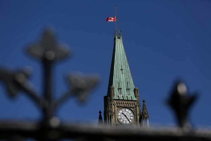 A Canadian flag flies at half-mast on top of the Peace Tower to mourn the victims of the of the Nova Scotia shooting April 20, 2020 in Ottawa, Canada.