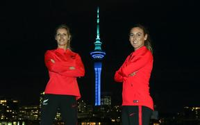 Ferns Erin Nayler and Annalie Longo pose for pictures ahead af the FIFA Women's World Cup 2023 hosting announcement. The Auckland Sky Tower lit in blue and green colours in support of the Australia / New Zealand Women's World Cup Bid, Viaduct.