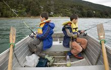 two boys fishing in the Marlborough Sounds