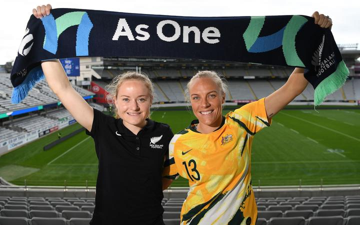 Paige Satchell and Tameka Yallop pose for a photo at Eden Park after New Zealand and Australia won the hosting rights to the 2023 FIFA Women's World Cup.