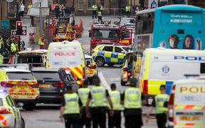 Police and emergency services respond at the scene of a fatal stabbing incident at the Park Inn Hotel in central Glasgow on June 26, 2020.