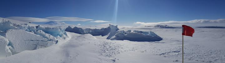 The pressure ridges in front of Scott Base form as the sea ice is pushed against the shore by the movement of the ice shelf behind. Mt Erebus in the background.