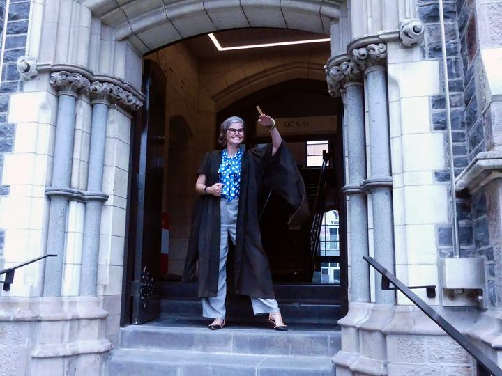 UC Arts City Location Manager Naomi van den Broek models a gown once worn on a daily basis by academic staff.