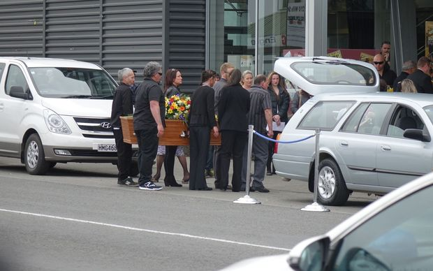 Peggy Noble's coffin is carried to the Ashburton Events Centre.
