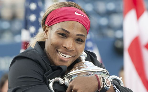 Serena Williams embraces the trophy.