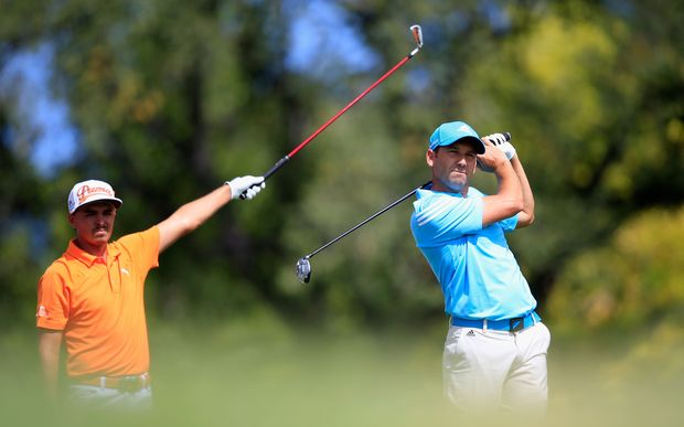 Rickie Fowler of the United States (left) watches the tee shot of Sergio Garcia of Spain during the BMW Championship.