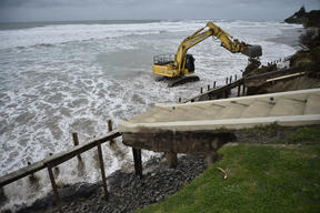 Surging tides eroded several metres of land in front of three Wainui properties last September.