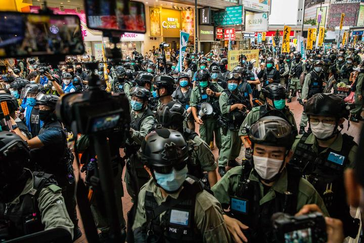 Riot police clear a street as protesters gathered to rally against a new national security law in Hong Kong on July 1, 2020, on the 23rd anniversary of the city's handover from Britain to China.