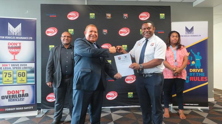 Motor Vehicles Insurance Limited Managing Director, Michael Makap (left), confirmed sponsorship for the Digicel Cup alongside Competition Manager Stanley Hondina.