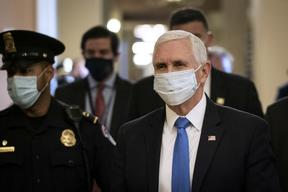 WASHINGTON, DC - MAY 19: Vice President Mike Pence wears a mask as he departs the office of Senate Majority Leader Mitch McConnell after meeting with him at the U.S. Capitol on May 19, 2020 in Washington, DC.