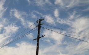 22363608 - electricity pylon against the blue sky