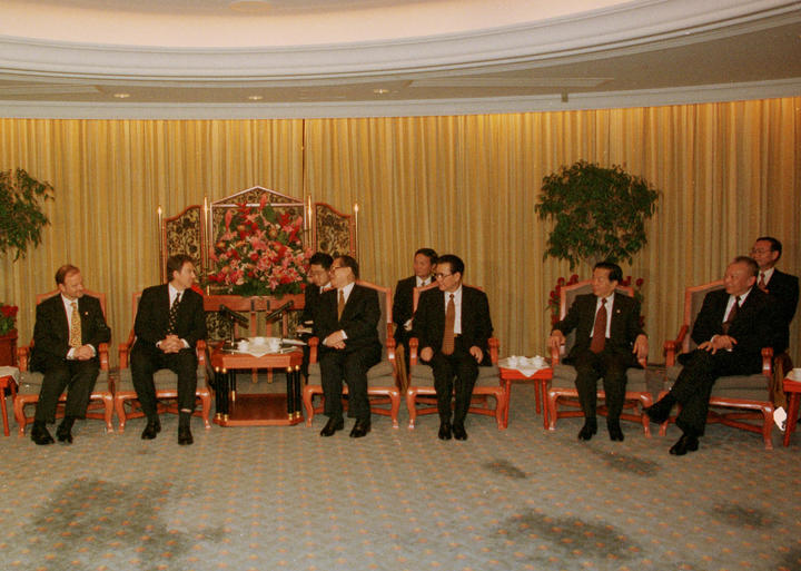 Chinese and British leaders meet in Hong Kong on 30 June 1997.