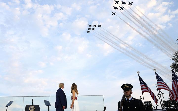 WASHINGTON, DC - JULY 04: U.S. President Donald Trump and first lady Melania Trump watch the U.S. Navy Blue Angels and U.S. Air Force Thunderbirds perform a flyover near the White House on July 04, 2020 in Washington, DC.