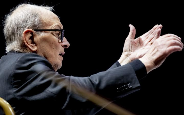 """21 January 2019, Berlin: Composer Ennio Morricone conducts the Czech National Symphony Orchestra (CNSO) and a choir of 75 singers on his """"The Farewell Tour"""" at the Mercedes-Benz Arena in Berlin."""