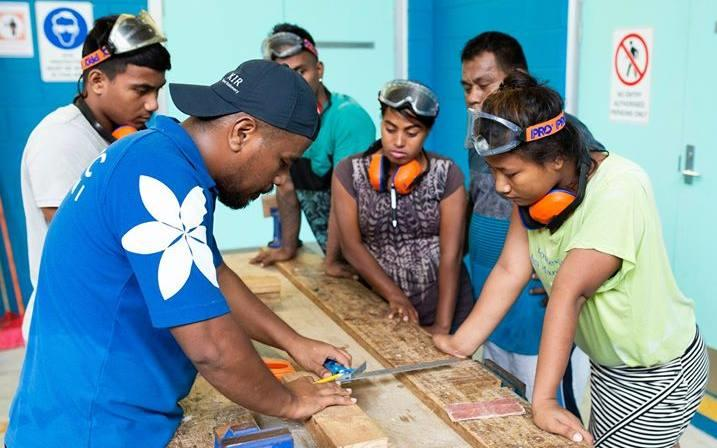 Students in Kiribati learning technical skills.