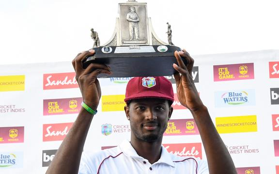 Jason Holder of West Indies with the Wisden trophy 2019.