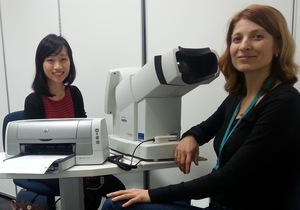 A photo of Lily Chang conducting an eye test on participant Rosica Petrova